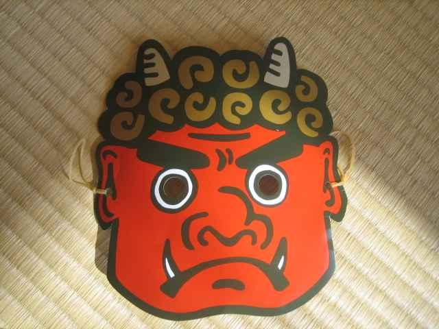 wears Oni mask with
